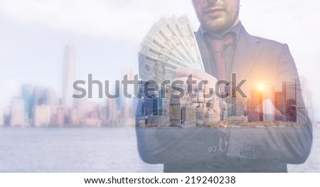 rich business man taking over the city. concept about economy and money. double exposure photo, business man picture over manhattan skyline - stock photo