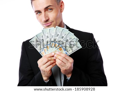 Rich businessman holding US dollars isolated on a white background