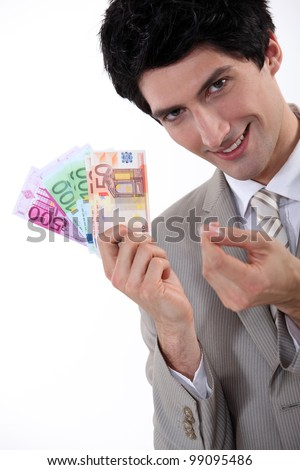 Rich businessman showing off his money