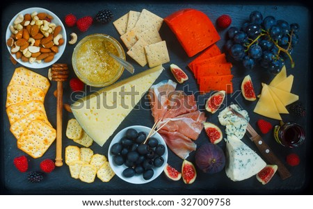 Rich Cheese Plate Board - stock photo