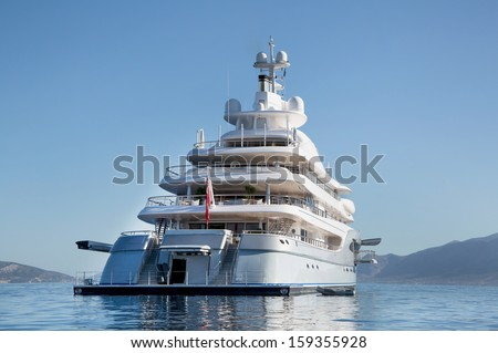 Rich - front view of five story luxury yacht on the Mediterranean Sea   - stock photo
