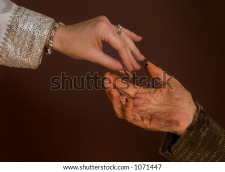 Rich hand giving alms to beggar - stock photo