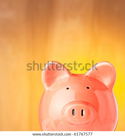 Rich looking Piggy Bank on a gold background.