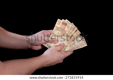 rich man holding money to pay someone - stock photo