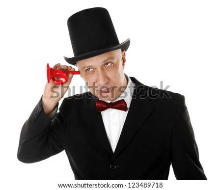 Rich man is listening in something with ear trumpet - stock photo