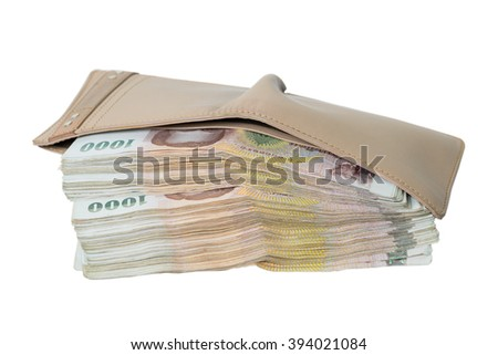 rich of money in wallet - stock photo