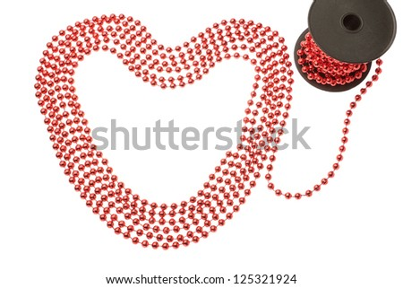 Rich red beads in the shape of a heart. On a white background.