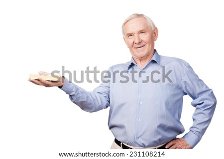 Rich senior man. Confident senior man in shirt holding money and looking at camera while standing against white background - stock photo