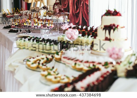 Rich sweets buffet prepared for a wedding dinner - stock photo