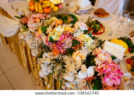 Rich table, decorated with flowers