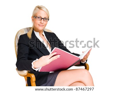 Rich young busness woman sitting in expensive antique chair. - stock photo