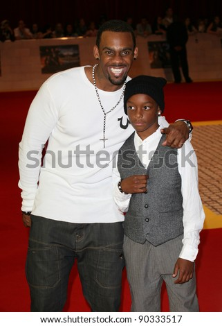 Richard Blackwood and son arriving for the UK Premiere of The Three Musketeers, at Westfield, London. 04/10/2011 Picture by: Alexandra Glen / Featureflash