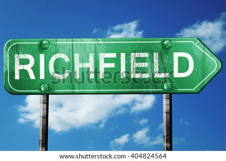 richfield road sign , worn and damaged look