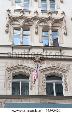 Richly decorated facade with American flag of Pariz hotel in Prague