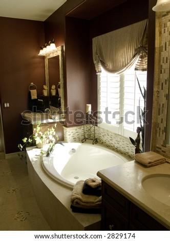 Richly designed bedroom master bathroom - stock photo