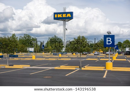 RICHMOND, BC, CANADA - MAY 30, 2013: Parking lot of Ikea store in Richmond on May 30, 2013. Founded in Sweden in 1943, Ikea is the world's largest furniture retailer