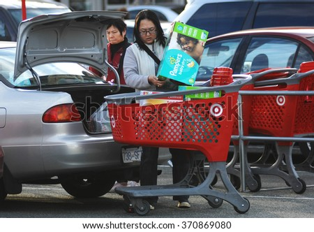 RICHMOND, CANADA - JANUARY 16, 2015: Customers make last purchases as Target closes all of it's 133 retail stores after less than two years in Canad, Jan.16, 2016 in Richmond, Canada. - stock photo