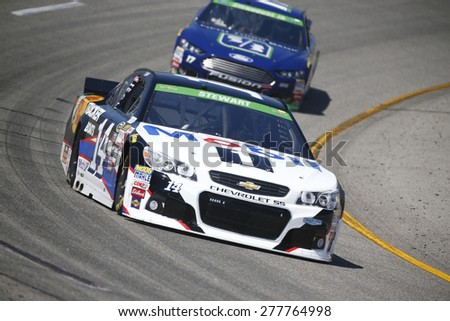 Richmond, VA - Apr 24, 2015:  Tony Stewart (14) brings his race car through the turns during a practice session for the Toyota Owners 400 race at the Richmond International Raceway in Richmond, VA. - stock photo