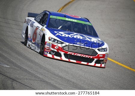 Richmond, VA - Apr 24, 2015:  Trevor Bayne (6) brings his race car through the turns during a practice session for the Toyota Owners 400 race at the Richmond International Raceway in Richmond, VA. - stock photo