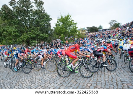 RICHMOND VIRGINIA - SEPTEMBER 27: Cyclists climb the cobblestones of Libby Hill in the elite men's road race at the UCI Road World Championships on September 27, 2015 in Richmond, Virginia  - stock photo
