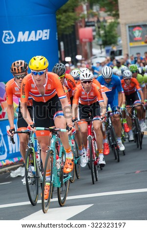 RICHMOND VIRGINIA - SEPTEMBER 27: Cyclists compete in the elite men's road race at the UCI Road World Championships on September 27, 2015 in Richmond, Virginia