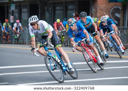 RICHMOND VIRGINIA - SEPTEMBER 27: Cyclists compete in the elite men's road race at the UCI Road World Championships on September 27, 2015 in Richmond, Virginia  - stock photo