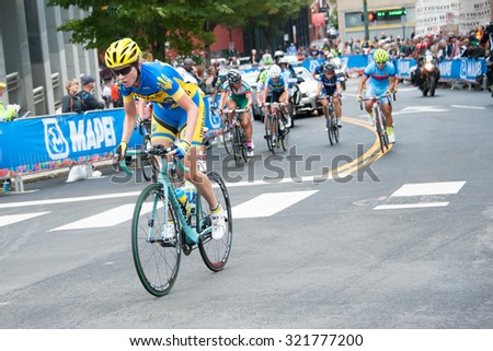 RICHMOND VIRGINIA - SEPTEMBER 26: Cyclists compete in the elite women's road race at the UCI Road World Championships on September 26, 2015 in Richmond, Virginia - stock photo