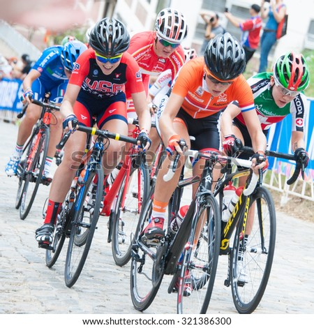 RICHMOND, VIRGINIA â?? SEPTEMBER 25: Cyclists tackle a cobblestone hill in the junior womenâ??s road race at the UCI Road World Championships on September 25, 2015 in Richmond, Virginia - stock photo