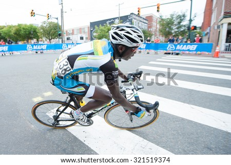 RICHMOND, VIRGINIA  SEPTEMBER 25: Jean Bosco Insengiylumva (RWA) competes in the under-23 men's road race at the UCI Road World Championships on September 25, 2015 in Richmond, Virginia  - stock photo