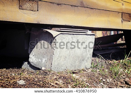 Rickety support of a country house - stock photo