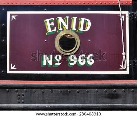 RICKMANSWORTH, UK - MAY 16, 2015. Hand painted shadow lettering on a narrow boat mooring at the Grand Union Canal at the town festival in Rickmansworth, England, UK.
