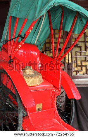 rickshaw close up and bamboo hat