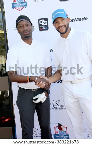 Ricky Smith and Stephen Bishop arrives at the inaugural Stephen Bishop celebrity golf invitational benefiting R.A.K.E. on Feb. 15, 2016 at Calabasas Country Club in Calabasas, CA. - stock photo