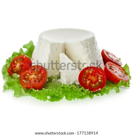 Ricotta Cheese in the lettuce leaves and tomato isolated on white background  - stock photo