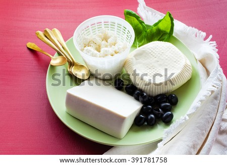 Ricotta, Feta and sheep Cheese.  group of white cheeses on the appetizers plate  - stock photo