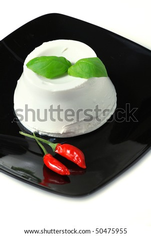 ricotta, italian cheese on black dish - stock photo