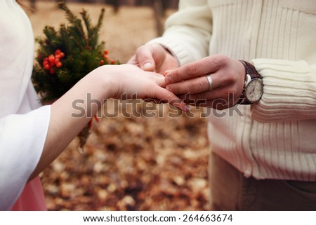 ride exchanged rings in the forest at wedding ceremony - stock photo