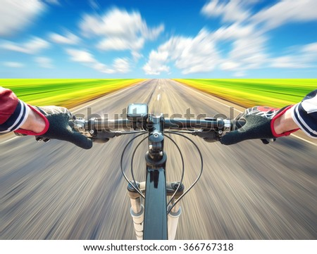 Ride on bike on road. Sport and active life concept