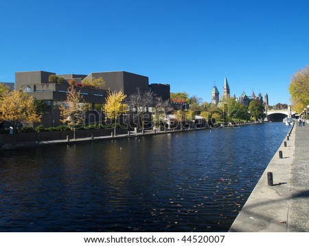 Rideau canal, Canadian parliament and National Art Centre - stock photo