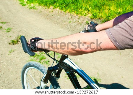 Rider driving bicycle on an off road