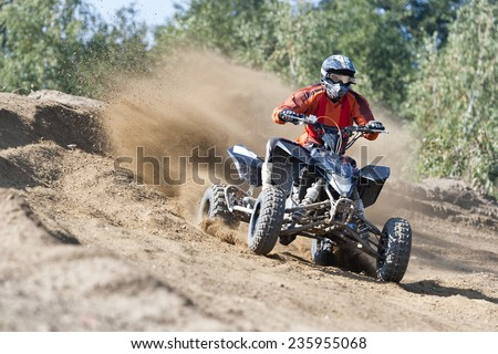 Rider driving in the quadbike race - stock photo