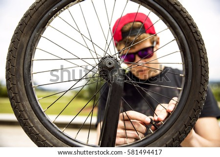 Rider fixing the tyre