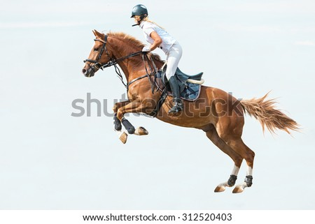 Rider jumping on horse on blue sky background