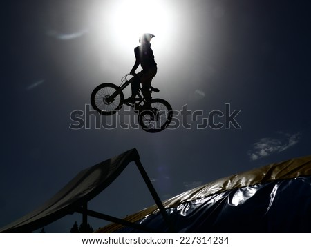 rider jumping with it dirtbike - stock photo
