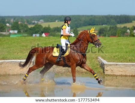 Rider on horse at equestrian event - stock photo