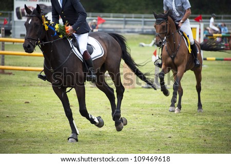 Riders in the jumping show - stock photo
