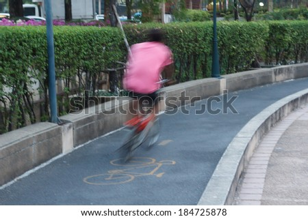 Riding a bike on bicycle lane , blurred motion abstract background - stock photo
