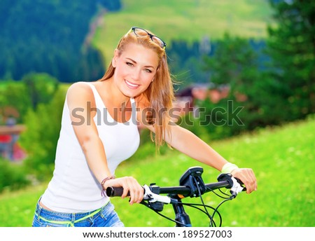 Riding bicycle in Alpine mountains