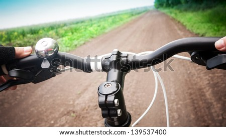 riding bicycle in summer - stock photo