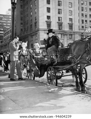 Riding in Style - carriage driver at Grand Army Plaza (the edge of Central Park) getting ready to take customers through the Park